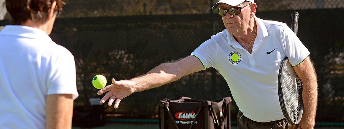 Edward Curtis Throws Tennis Ball