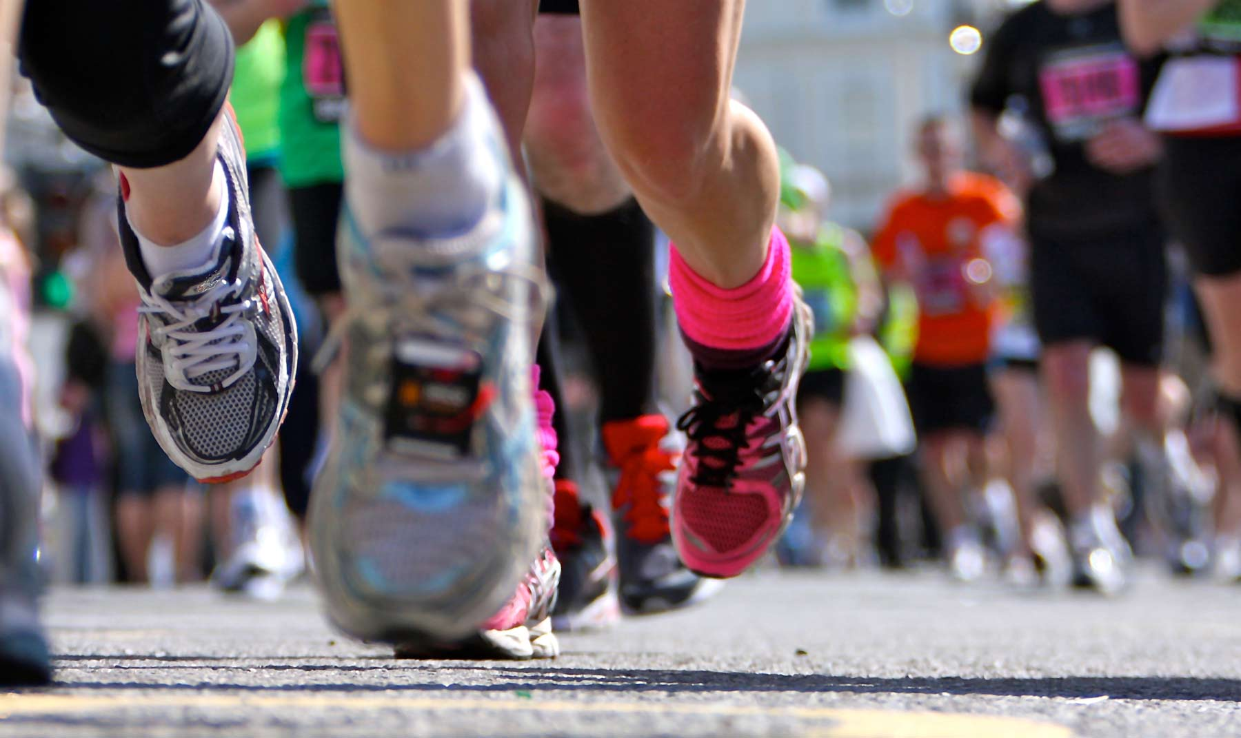 Close up of runner's shoes during a marathon