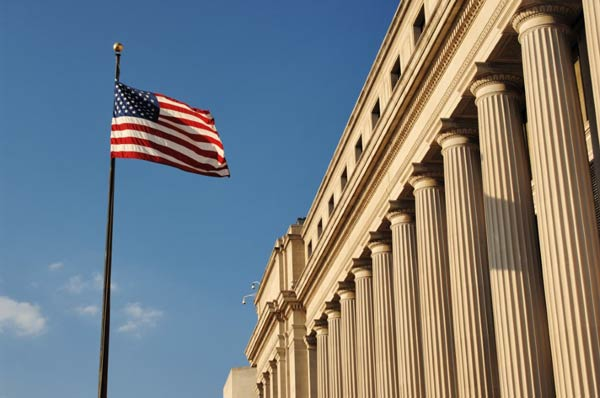 U.S. Flag raised outside of the Capitol building