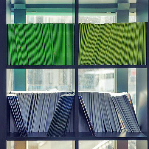 rows of files stacked on a shelf