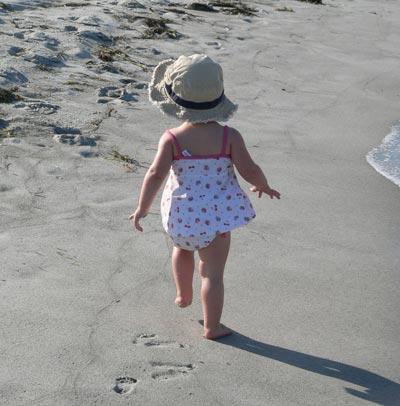 Toddler on sandy beach