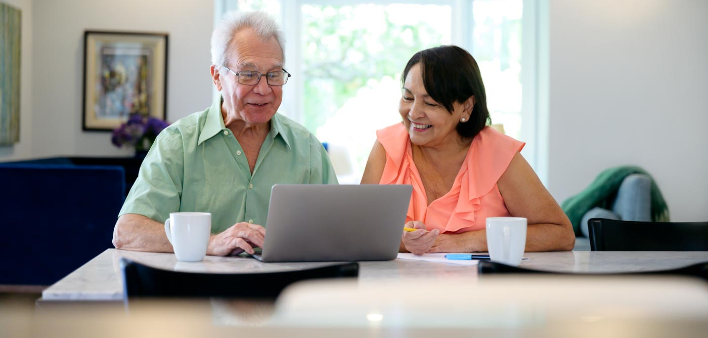 elderly couple in a web meeting