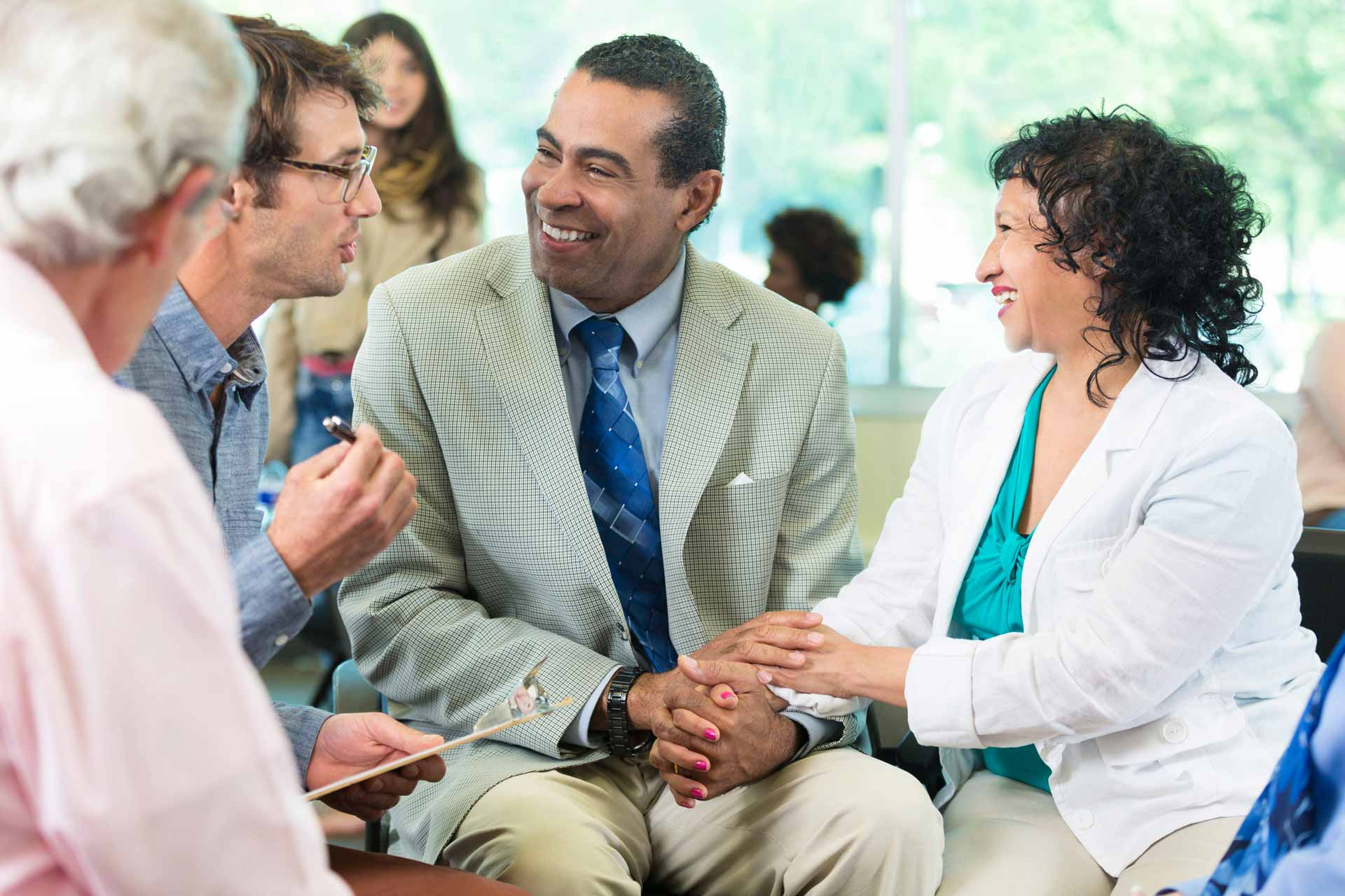 image of diverse couple in a support group meeting