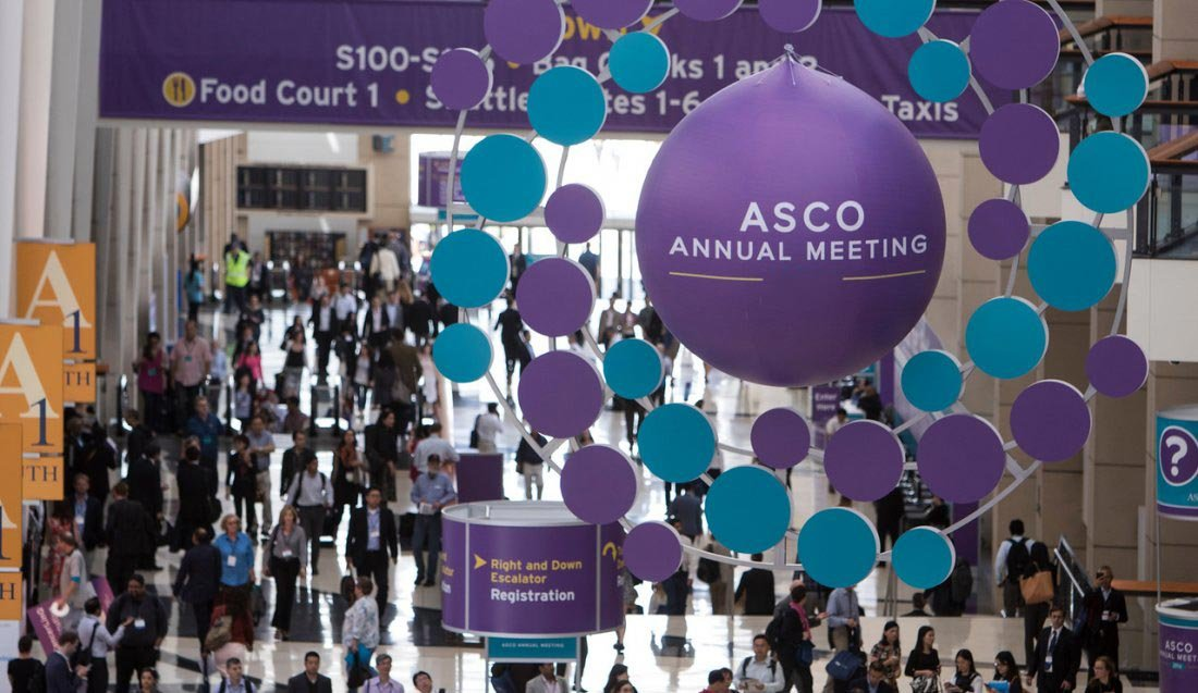 A crowded lobby of attendees at the ASCO annual meeting