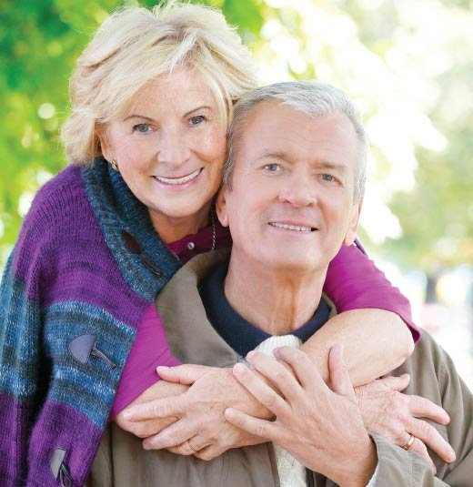 Elderly couple posing together