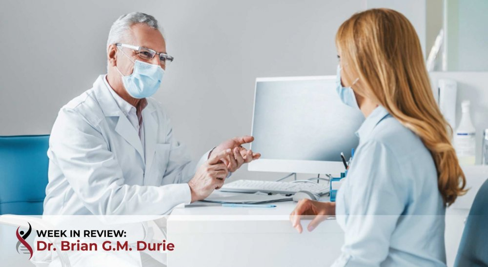 Doctor patient in office with masks on