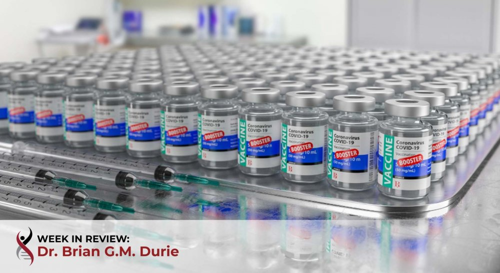 multiple covid 19 vaccine booster vials on table