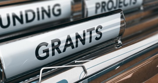 "hanging file folders with tabs for ""Funding"" and ""Grants"""