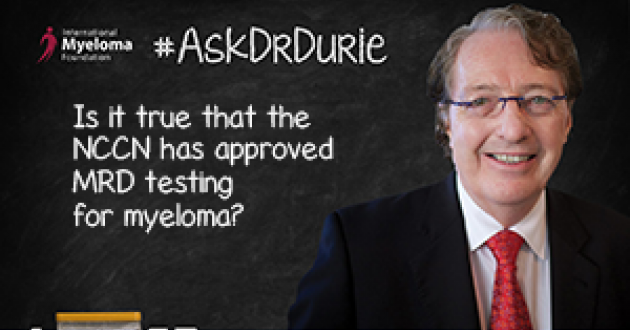 Dr. Durie in fornt of a chalk board