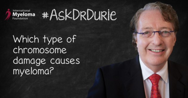 Dr. Durie in front of a chalk board