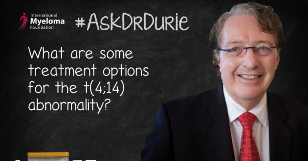 Dr. Durie in for of a chalk board