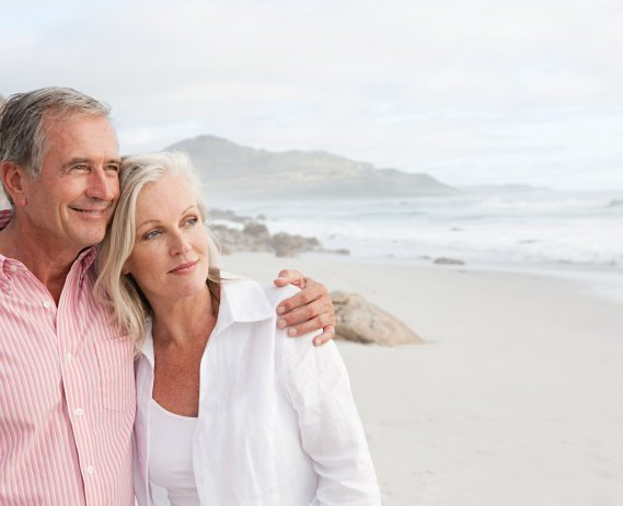 couple looking at beach cover