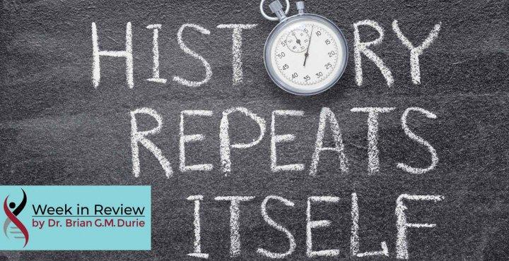 "Chalkboard with writing ""history repeats itself"""