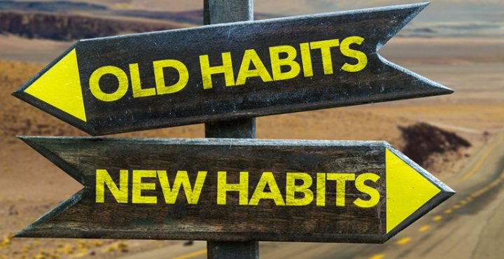 Image of a road sign, one way pointing to old habits, one way pointing to new habits
