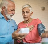 elderly couple checking blood pressure