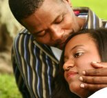 african-american couple comforting each other