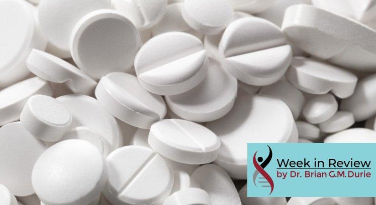 image of a pile of white aspirin pills