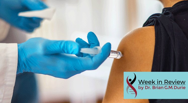 Gloved hand injects needle in arm