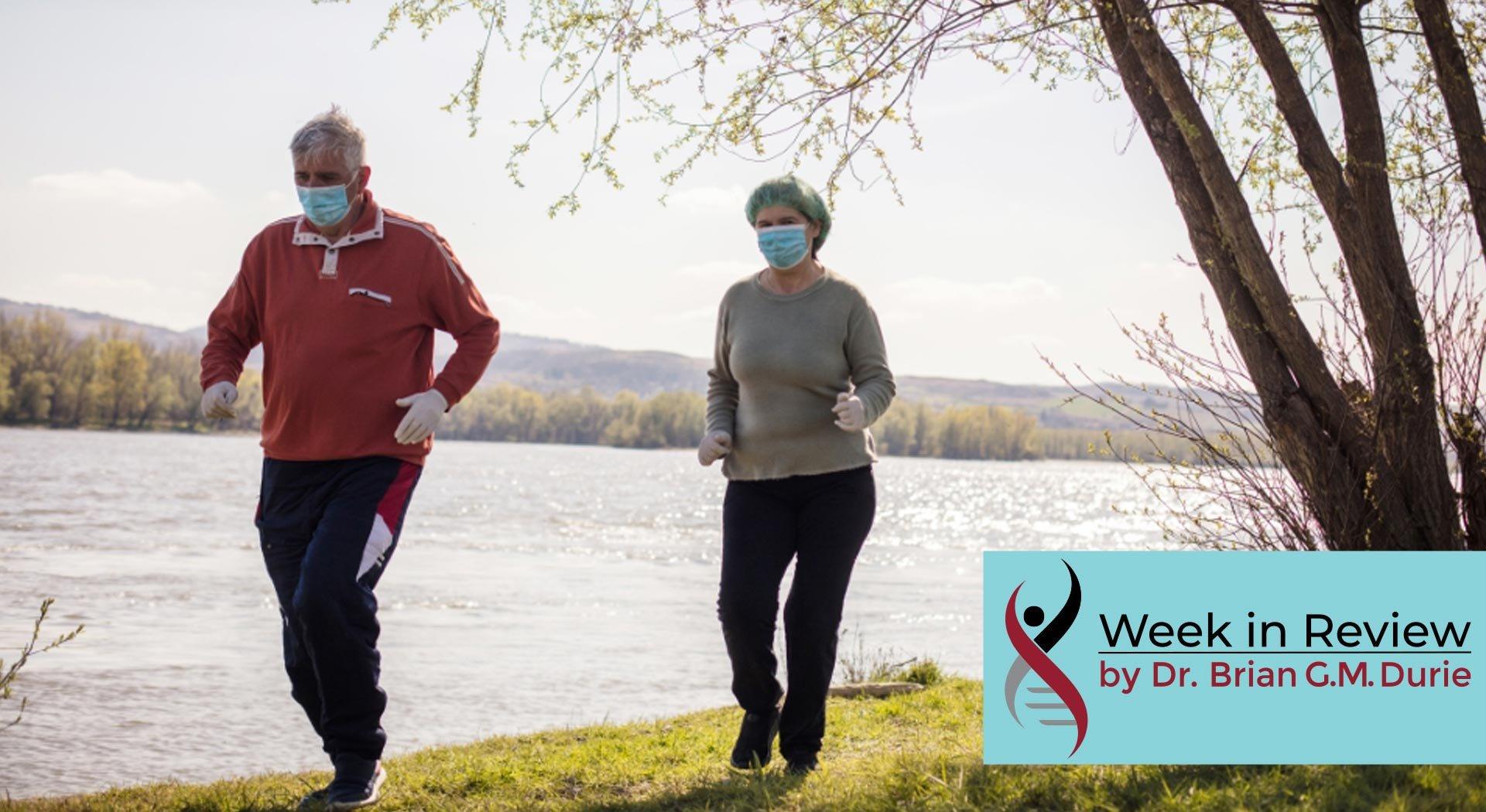 senior couple walking in masks