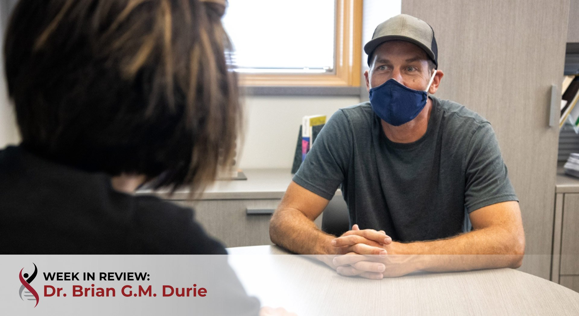 Health care worker with patient in mask
