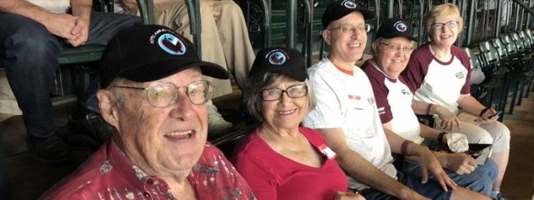 support group warriors watching baseball game
