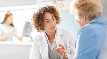 Doctor speaks to patient