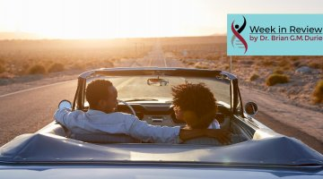 blog couple driving into sunset
