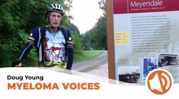 Myeloma Patient Doug Young rides a bicycle