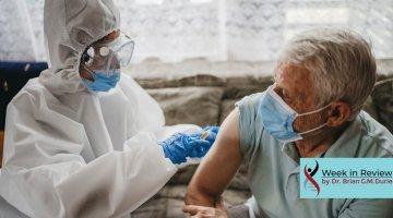 Doctor giving vaccine shot to elderly