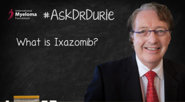 Ixazomib FDA approval text overlaid on an image of Dr. Durie in front of a chalk board