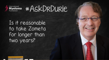 Video still of Dr. Brian G.M. Durie on chalkboard backdrop with text overlay: Is it reasonable to take Zometa for longer than two years?