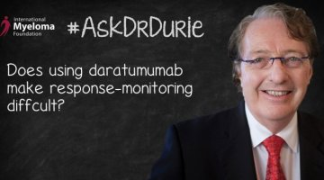 """Video still of Brian G.M. Durie with chalkboard backdrop and text overlay: """"Does using daratumumab make response-monitoring difficult?"""""""