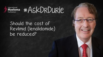 "Video still of Dr. Brian G.M. Durie on chalkboard backdrop with text overlay: ""Should the cost of Revlimid (lenalidomide) be reduced?"""
