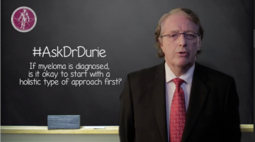 Dr. Durie headshot in front of chalk board